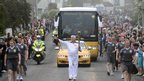 John Shaw carrying the Olympic flame on the leg between Bristol and Nailsea