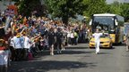 Clive Burrows carrying the Olympic Flame on the leg between Chippenham and Calne
