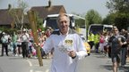 David Hemery carrying the Olympic Flame
