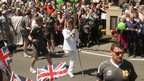 Ben Fox carrying the Olympic flame