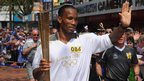 Didier Drogba carrying the Olympic flame