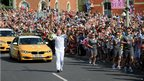 Dennis Rigley carried the Olympic flame on the leg between Stroud and Shurdington