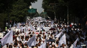 Demonstrators dressed in white march in Guadalajara