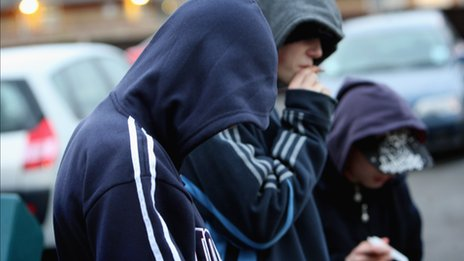 Young persons in hooded tops