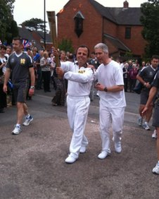 Paul Watts carries the torch