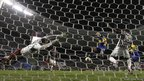 Santiago Silva of Argentina's Boca Juniors scores against Brazil's Fluminense