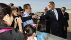 US President Barack Obama shakes hands with well-wishers upon his arrival in San Jose