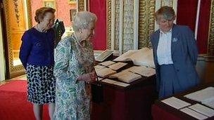 The Queen inspecting Queen Victoria's journals