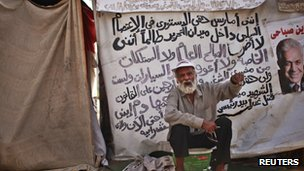 A man whose son was killed during the revolution sits outside his tent in Tahrir Square
