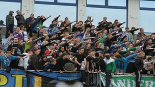 Supporters doing Nazi salute at a Ukrainian football stadium