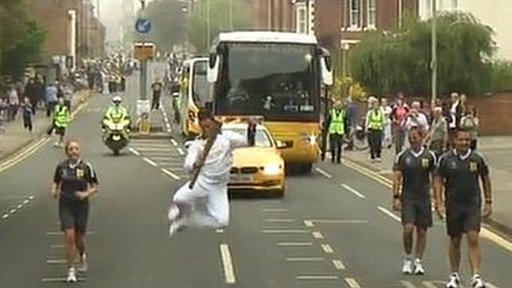 Man jumps while carrying torch