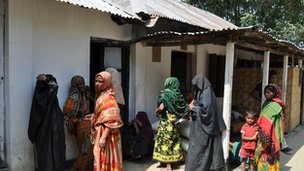 Village women waiting outside the clinic