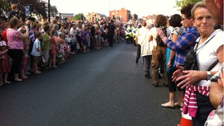 Crowds celebrating the torch arrival