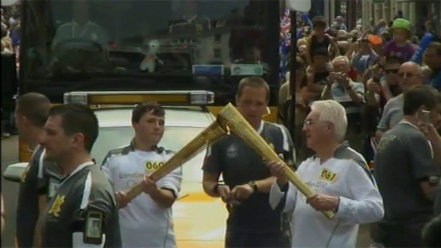 Jordan Baxter (left) carries the torch in Leominster
