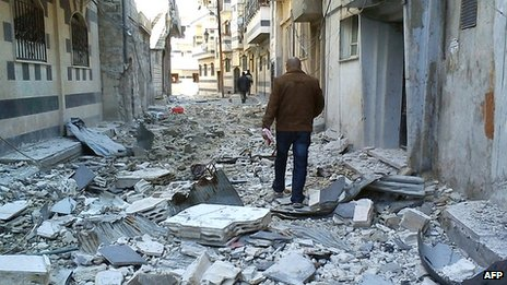 Debris seen in a street of the Syrian city of Homs after alleged shelling by government forces on 19 April 2012 (file picture)