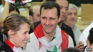 Syrian president Bashar al-Assad and his wife, Asma, attend an event at Al-Fahya Stadium in Damascus on 18 April 2012