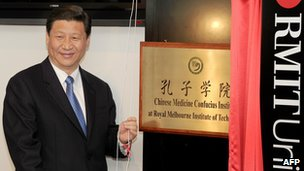 Chinese Vice President Xi Jinping unveils the plaque at the opening of Confucius Institute at the RMIT University in Melbourne, Australia, 20 June 2010