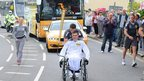 David Follett carrying the Olympic torch on the leg between Torrington and Bideford.