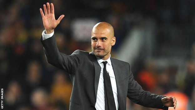 Pep Guardiola waves to the Barcelona fans