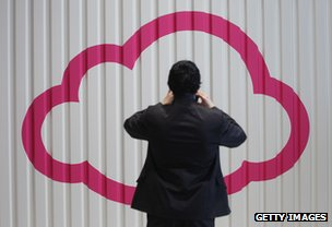 Visitor to German technology trade-fair photographing symbol of cloud