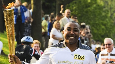 Olympic gold medallist, Darren Campbell carrying the flame on the leg between Worcester and Powick on Friday