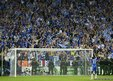 Chelsea's Didier Drogba waves to supporters after victory in the Champions League final