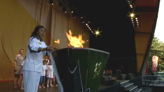 Melanie Stephenson lights the Olympic cauldron in Cardiff's Cooper's Fields