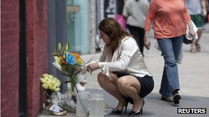 Marisa Perry of New York lays flowers where Etan Patz was allegedly murdered 33 years ago in New York 25 May 2012