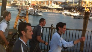 Matt Smith running with the torch