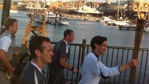Matt Smith running with the torch