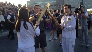 Matt Smith passes the flame to Llio Roberts