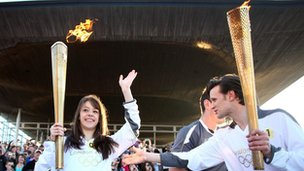 Doctor Who star Matt Smith passes the Olympic torch to young swimmer Llio Roberts