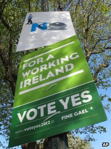 Posters for and against the EU fiscal treaty are attached to a lamppost in Dublin