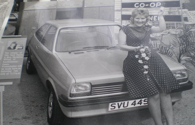 Christine Warren perched on a silver ford fiesta in 1977
