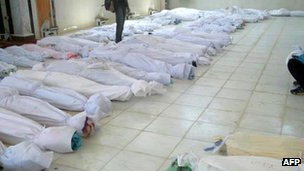 A handout picture released by the opposition Syrian opposition's network shows bodies lying at a hospital morgue before their burial in the central Syrian town of Houla (26 May 2012)