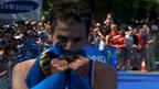 Britain's Jonathan Brownlee celebrates victory in Madrid
