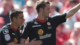 Nick Powell celebrates scoring Crewe's first goal