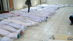 A handout picture released by the opposition Syrian opposition's Shaam News Network shows bodies lying at a hospital morgue before their burial in the central Syrian town of Houla on May 26, 2012.