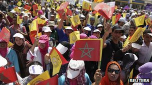 Protesters wave Moroccan national flags during a demonstration for social reform in Casablanca, May 27, 2012