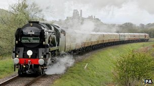 Steam train passes Corfe Castle