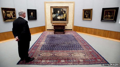 Visitor looking at Christ and Disciples of Emmaus (centre) and other paintings by Han van Meegeren (1889-1947) at the Boijmans Van Beuningen Museum in Rotterdam in 2010