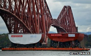 Hull section of aircraft carrier HMS Queen Elizabeth passes under the Forth Bridge