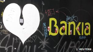 Bankia logo covered in grafitti