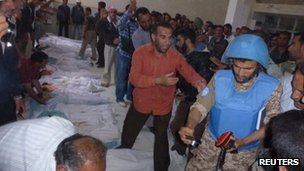 UN observers inspecting victims of the Houla massacre