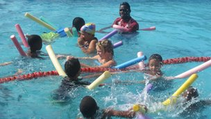 Children have a school swimming lesson
