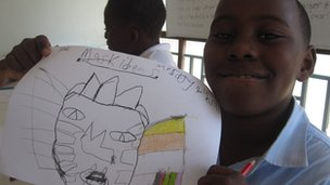 Sean with his drawing of an African mask