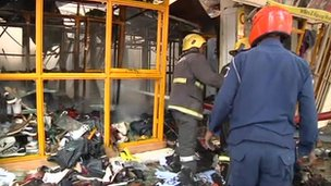 Rescue workers at the site of the explosion