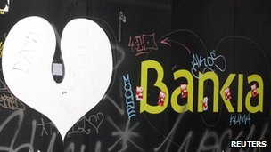 The logo of the Bankia bank is seen on a wall in Madrid