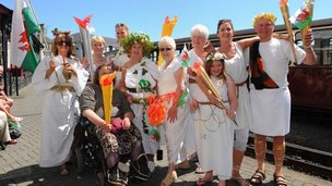 Fancy dress welcome for torch in Blaenau Ffestiniog