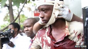 A man injured during an explosion is assisted from the scene in Kenya&#039;s capital Nairobi, May 28, 2012. 